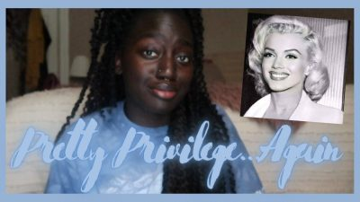 """Black woman wearing a light blue T-shirt and black-and-white image of white, blonde woman with the words """"Pretty Privilege... again"""" over them"""
