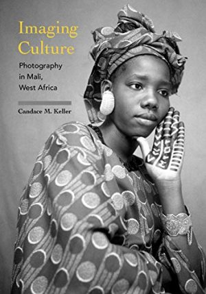 Book cover with black-and-white portrait of a woman wearing a shawl with circles and stripes and a matching headscarf