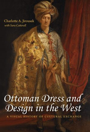 Book cover with portrait of man wearing a turban and a cape in the background