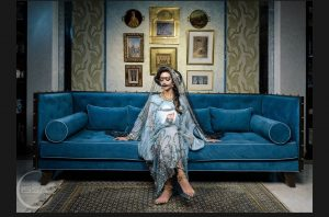 Woman in Arab Dress on Blue couch
