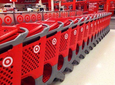 A photograph of shopping carts inside a Target retail store.