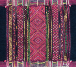 Textile with vertical stripes made of lozenges and zig-zagging motifs