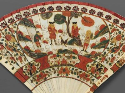 Fan with flowers, trees, and human figures in red, orange and green colors