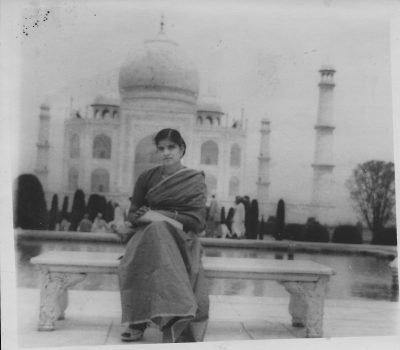 Chopra, Prem Shil. Prem Lata Chopra in Agra. Photograph. Agra, India, 1960. Prem Lata Chopra sitting in front of the Taj Mahal in a sari.