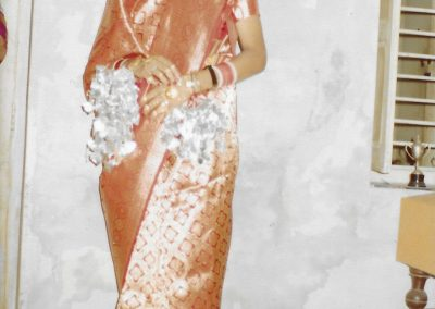 Chopra, Prem Shil. Sunita Chopra Pasi. Photograph. New Delhi, India, 1982. Sunita Chopra Pasi wears a red sari to her wedding.