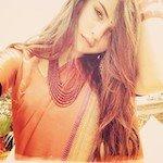 Image of Selena Gomez wearing a peach sari