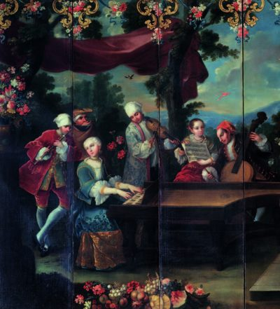 Close-up of folding screen with a painted scene of men and women sitting around a piano, which is being played by one of the woman, in an outdoor space with flowers and trees