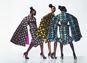 Vlisco campaign with three women wearing multi-colored dresses with patterns with star-shaped motifs