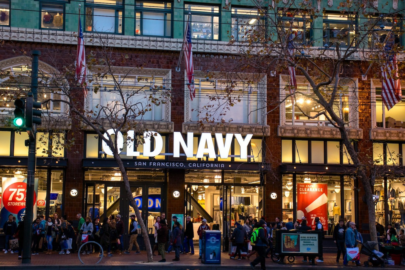 street-level view of the storefront of Old Navy on a busy city street