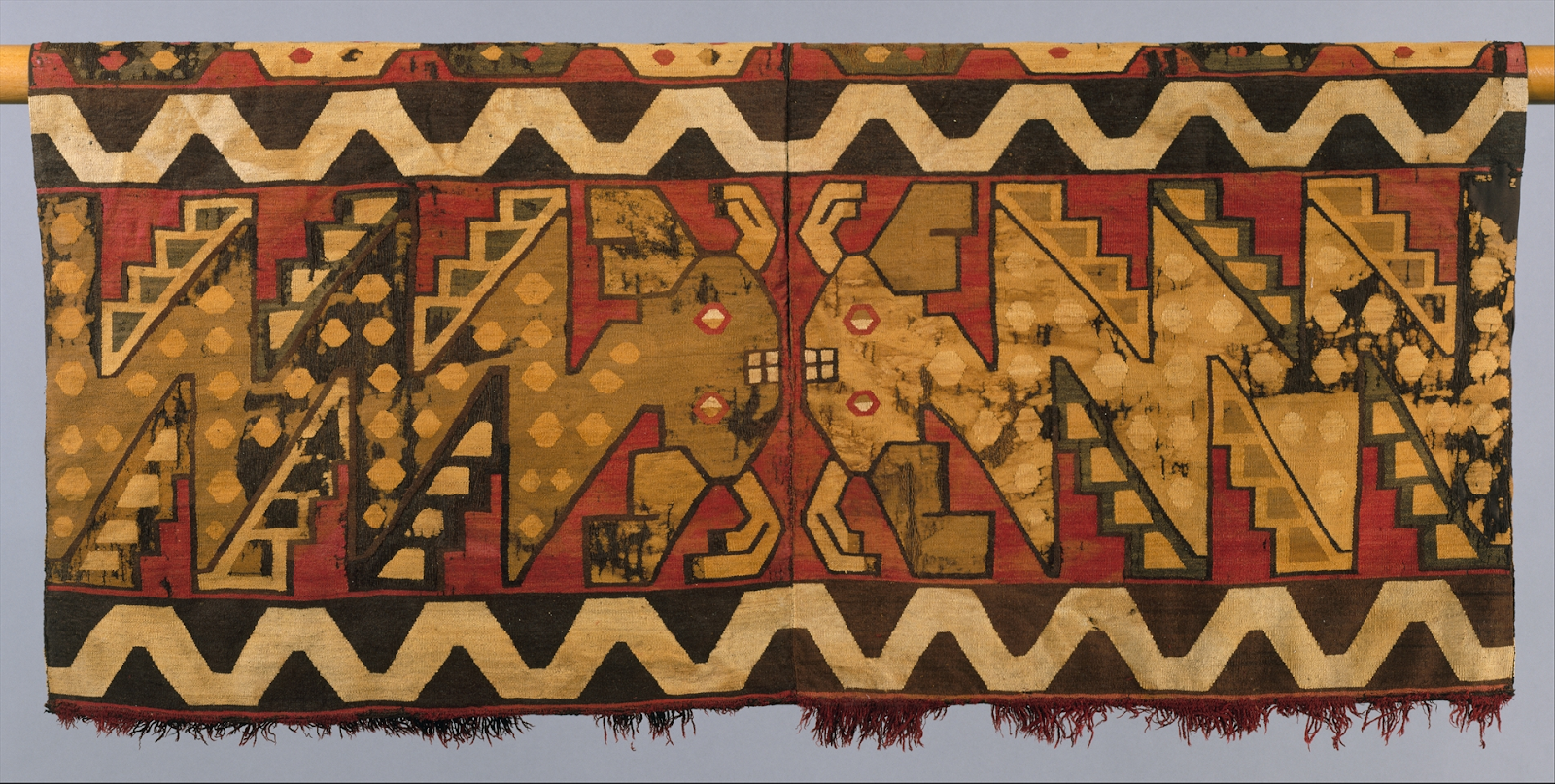 Tunic with Confronting Catfish. Camelid hair, tapestry-weave, 54.6 × 109.9 cm.