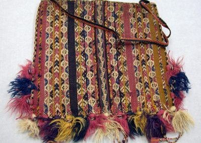 Photograph of a multi-colored ch'uspa with small tassels on the lower border