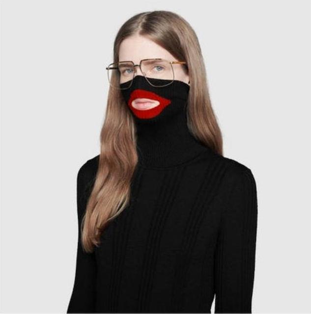 White model wearing a Gucci baclava style turtleneck sweater resembling blackface