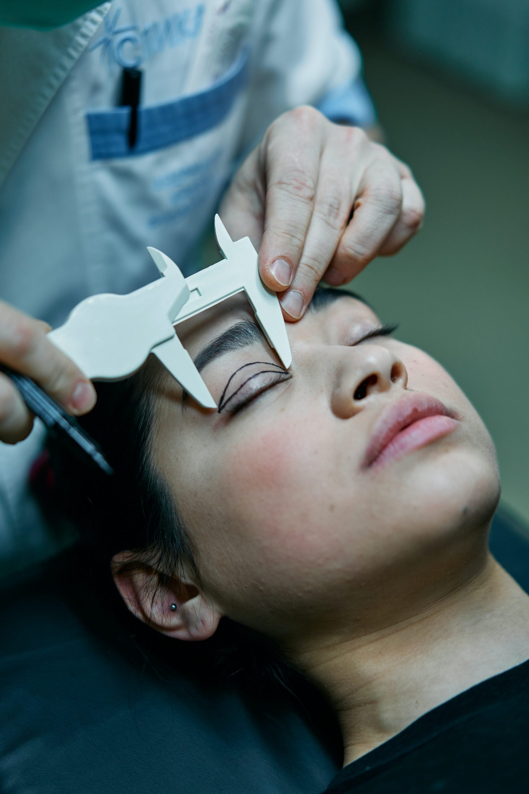 Woman receiving plastic surgery consultation on eyes.