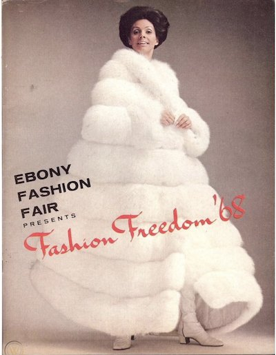 """A model in a white fur coat twirls, red type reads """"Fashion Freedom '68"""""""