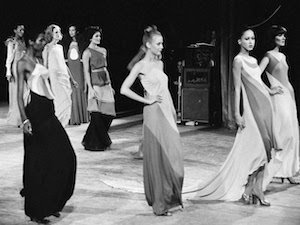 Black and white photograph of models walking the runway at the Battle of Versailles.