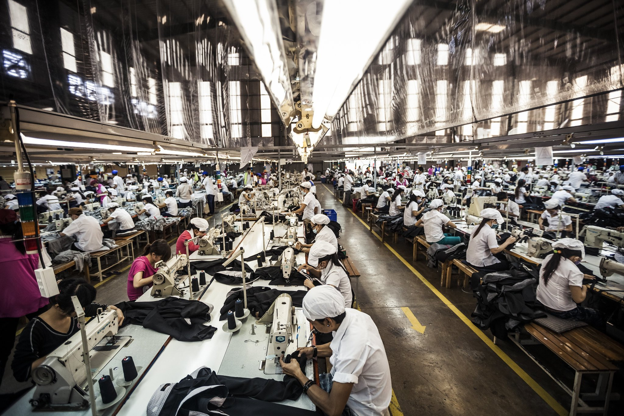 Photograph of factory workers at sewing machines