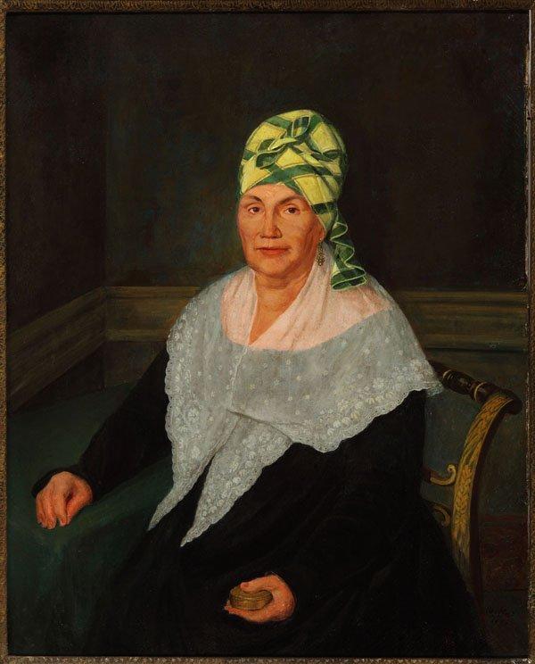 Portrait of a woman wearing a madras head wrap