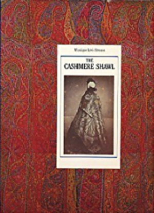 Book cover with photo of woman wearing a cashmere shawl