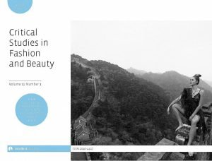 Journal cover with a black-and-white photo of a person wearing a short, black dress and mountains in the background