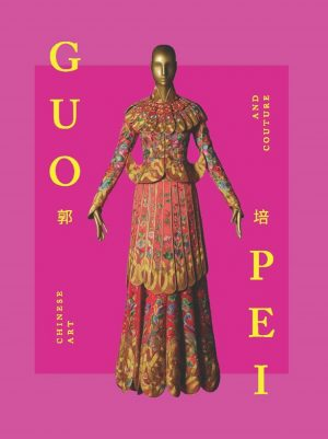 Book cover with yellow letters on hot-pink ground and an image of a dress on a gold-color mannequin in the center