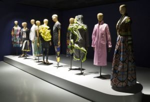 Gallery view with row of dressed mannequins