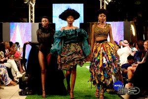Photo of three black models walking down the runway of Accra Fashion Week
