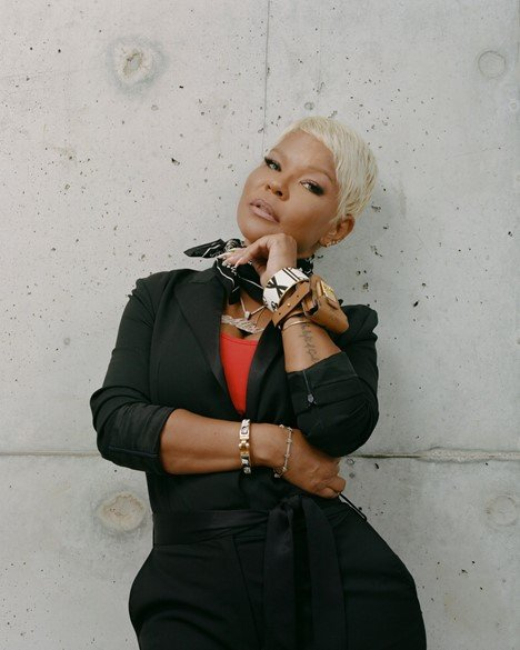 Misa Hylton poses in front of a concrete wall