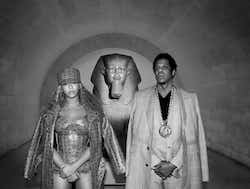 Beyonce and Jay Z seen in custom MCM. They are posed in front of a Sphinx statue.