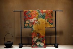 Exhibition gallery view with a kimono with floral designs