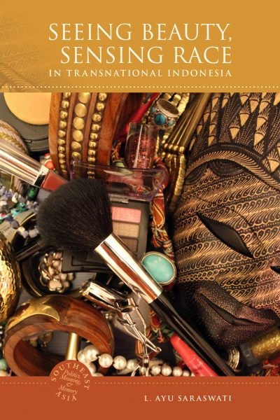 Book covering feature a close-up of makeup and bracelets, focusing on a makeup brush in the centre