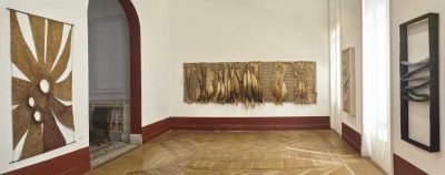 Gallery view with textiles hanging on the walls