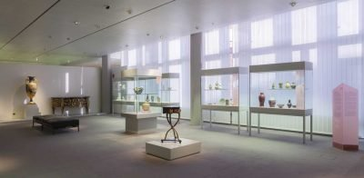 Gallery view with ceramics mounted on glass vitrines