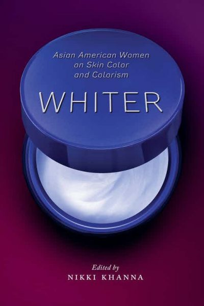 Book cover with a a skincare product halfway opened to reveal a white cream inside
