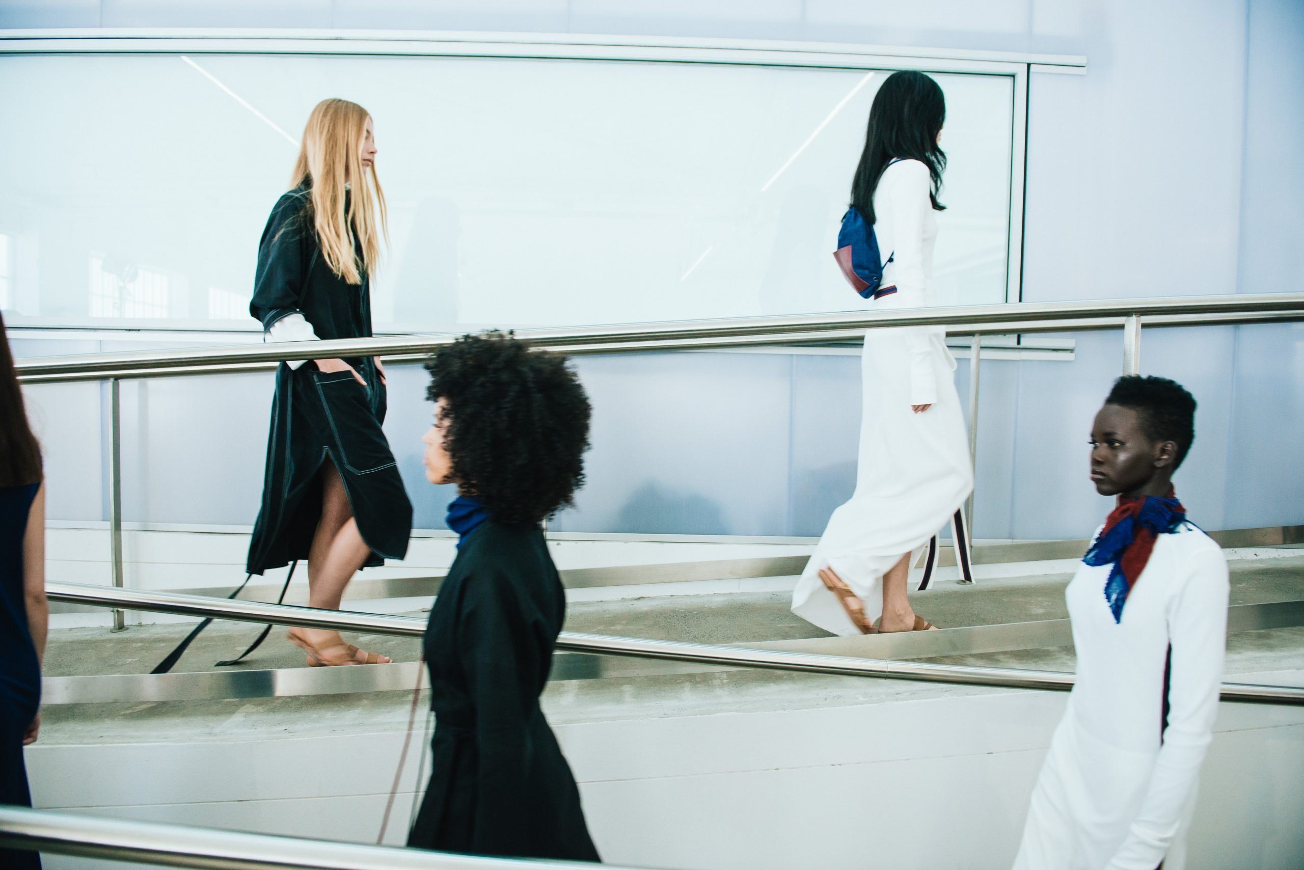 Image of models walking the runway during a fashion show.