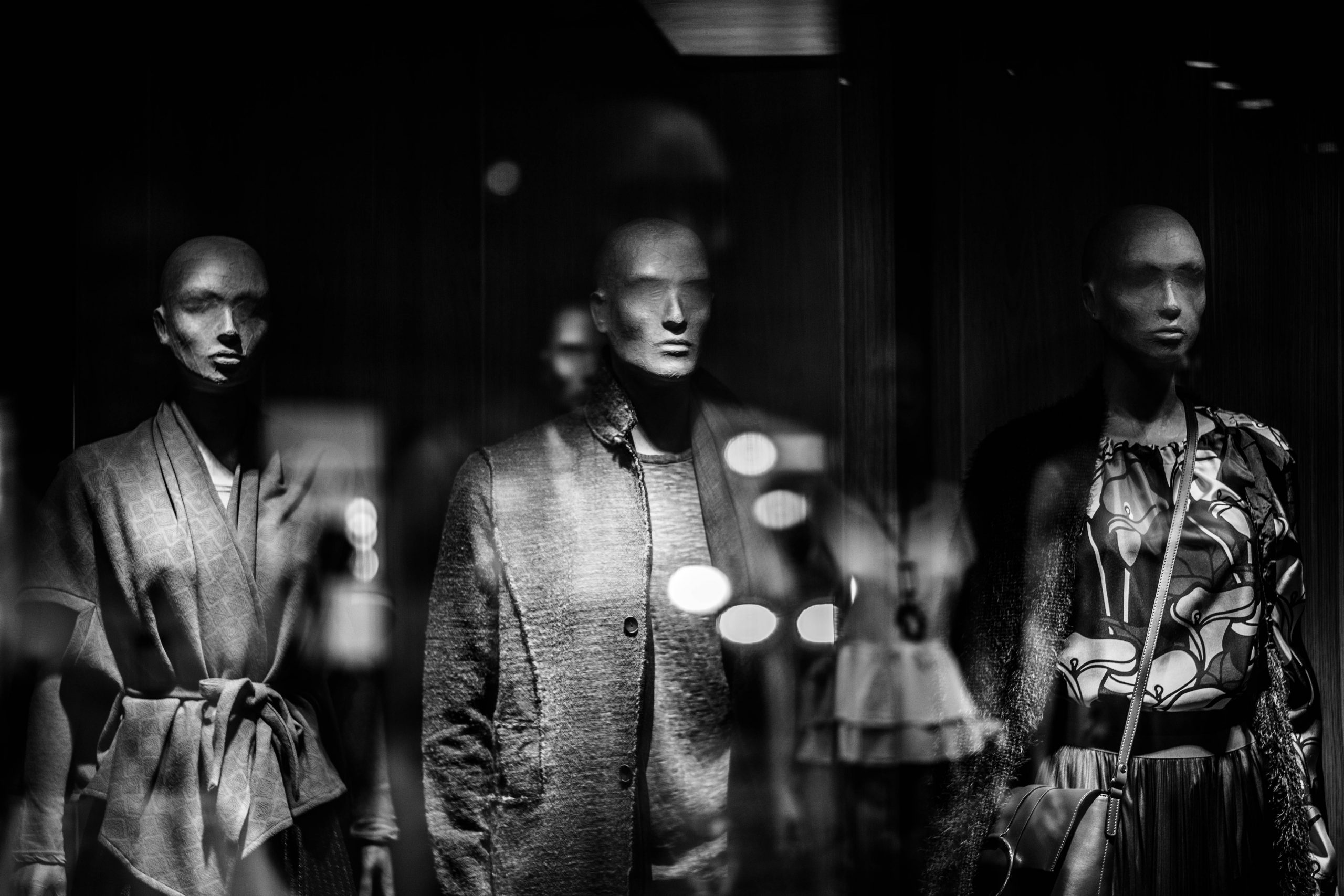 Black and white image of dressed mannequins