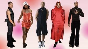 Five Black designers standing in front of a red gradient background
