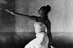 Black and white picture of woman stretching her arm out