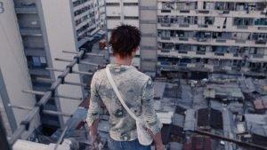 Man looking down at city.