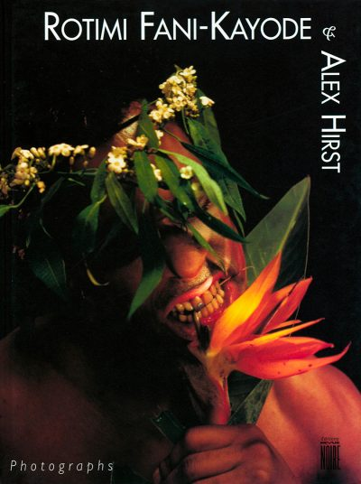 A man wearing a flower hat biting into a flower