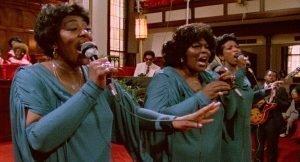 Three women performing in a church.