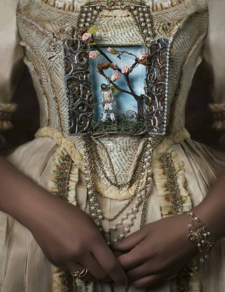 close-up photo of the torso of a woman wearing a custom-made dress, adorned with a window where the wearer's heart would be